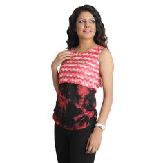 This top from Apella is just what you need to make a style statement. This trendy top as round neck and also has beautiful design on the back.