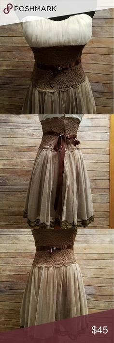 Homecoming Dress Worn once for Home Coming.  Pair this with some cowboy boots for a more casual look.  May want to get it dry cleaned but could be worn as is.  Gently used condition. Dresses Strapless