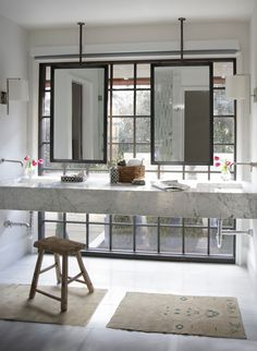 This master bathroom features floating marble vanity custom steel ceiling mounted mirrors black steel windows and motorized privacy screen Christopher ... & 163 best Mirrors images on Pinterest in 2018 | Master bathrooms ...