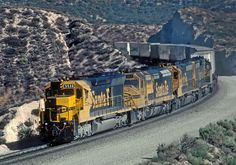https://flic.kr/p/PctoJb   ATSF 5538 just west of Cajon Summit heading east in August 1981   A Roger Puta Photograph