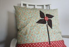 Lots and lots of Tutorials. This one : Turned-Edge Appliqué Pinwheel Pillow