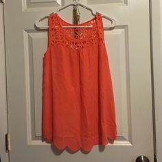 Peach colored top! 10/10 condition top, decorative around the top half and cuts in the back! (Color:peachy) Mine Tops Tank Tops