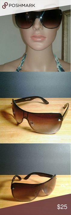 Aldo Sunglasses Aldo Sunglasses Brown w/ small silver Linning at the bottom lens under the tint... for high fashion appearances... in excellent condition... no marks, fits S/M... NWOT/ NEVER WORN!!! Aldo Accessories Glasses