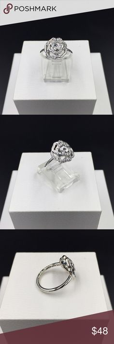 """Pandora Ring New Pandora """"Shimmering Delicate Rose"""" ring, size 6 (52).  Sterling silver and clear cubic zirconia.  Properly hallmarked S925 ALE. Pandora box not available. No trades or off Poshmark transactions. Thanks and happy Poshing!! Pandora Jewelry Rings"""