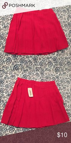 Red pleated mini skirt! Red pleated mini skirt. Never been worn because it's too short on me, I'm 5'7. Forever 21 Skirts Mini