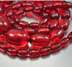 Luminous genuine cherry amber bakelite barrel beads form this long heavy circa 1920s Art Deco necklace! The vintage necklace has graduated rich cherry amber bakelite beads ending with the original scr