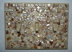 Seashell crushed mosaic light switch plate.