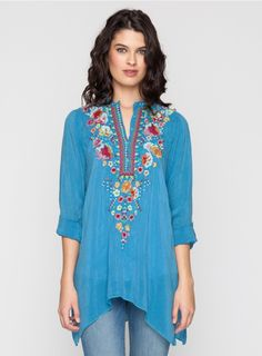 Sable Tunic The Johnny Was SABLE TUNIC features a playful scattered floral embroidery design in vibrant red, pink, orange, and blue. With a three button henley front, long tabbed sleeves, and a handkerchief hemline, this embroidered tunic top is as figure-flattering as it is chic! - Rayon Georgette - Mandarin Collar with Three Button Henley Front, Long Tabbed Sleeves, Handkerchief Hem, Tunic Length - Signature Embroidery - Care Instructions: Machine Wash Cold, Tumble Dry Low