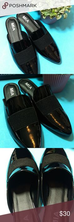 🌟New Mia Patent Slides🌟 ITEM: Mia vegan patent loafer slides with decorative elastic band, nonskid rubber sole  COLOR: Black patent vegan leather  CONDITION: New  DAMAGE: Slight, non-noticeable smudge on sides.  MEASUREMENTS: Approx. 11 inches toe to heel   Ships WITHOUT box due to the size of mailing box. Please ask any questions. Item sold as is. 🎆🎆🎆Bundle and save!🎆🎆🎆 Mia Shoes Flats & Loafers