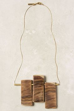 """Balanced Necklace #anthropologie  Hand-cut wooden beams, positioned on a slim brass bar. Handmade in Israel by the design duo Noritamy.  Lobster clasp  24k gold plated brass, wood  22""""L  5"""" bib  Handmade in Israel"""