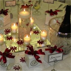 Red And White Wedding Reception Table Centerpieces and Decorations- Floating Candles with Red Bows
