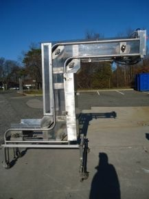"""1-USED SMALLEY MANUFACTURING STAINLESS STEEL """"Z"""" BUCKET ELEVATOR, S/N 2218.  ON CASTERS FOR PORTABILITY, ELEVATOR HAS APPROX. 3 FT. LONG INFEED SECTION TOP REACH SECTION OF APPROX. 55 IN . LONG AND PRESENT DISCHARGE HEIGHT OF APPROX. 80 IN.  WITH TOP MOUNTED DRIVE MOTOR, UNIT HAS CUTLER HAMMER STAINLESS STEEL STARTER BOX."""