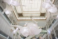 within paris' le bon marché rive gauche department store, ai weiwei presents an expansive exhibition of bamboo and paper installations.