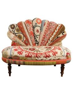 LOVE this mismatched fabric couch.