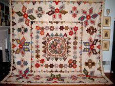 ANTIQUE CENTER MEDALLION QUILT~1820'S~VERMONT   eBay; 121 x 120 inches, not quilted, no batting.
