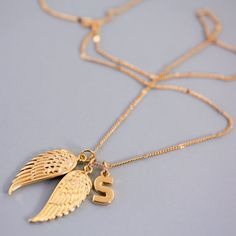 A cool double angel wing necklace made with our unique charms. This angel wing charms have a cute infinity detail. Personalise this necklaces