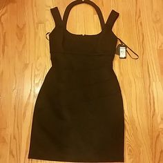 GUESS BLACK DRESS Guess  dress. Color black. Brand new tags attached. Size 8. Above knee length. Beautiful for a night out. Zipper on back. Guess Dresses