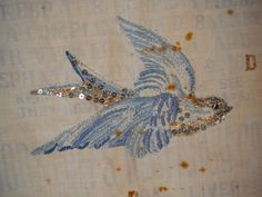 embroidered a blue bird on an old flour sac.....quick before it flies away