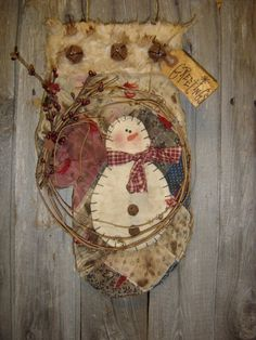 Grungy & Stained Old Quilt...snowman mitten...with rusty bells & twiggy wreath.