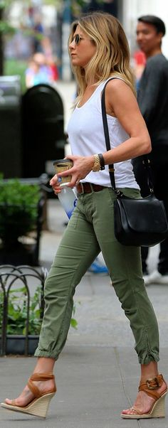 Jennifer Aniston: Sunglasses – Oliver Peoples Purse – The Row Necklace = Jennifer Meyer Pants – Nili Lotan Shoes – Burberry Shirt – Eileen Fisher