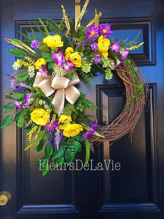 NEW!  This bright and cheerful spring wreath is now available and ready to be apart of your home. Made up on an 18 grapevine wreath with moss,