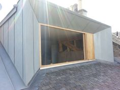 Zinc-clad loft extension by Konishi Gaffney creates an extra bedroom Scottish studio Konishi Gaffney has constructed a huge dormer window to convert the loft of a terraced house in Edinburgh into an extra bedroom.