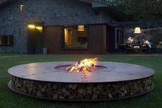 Tagged: Outdoor, Back Yard, and Grass. Photo 8 of 8 in Gather Around These 7 Modern Fire Pit Designs. Browse inspirational photos of modern outdoor spaces. From yards and gardens to patios and pools, explore design options for the ideal outdoor escape. Modern Outdoor Fireplace, Modern Outdoor Furniture, Outdoor Fireplaces, Outdoor Living, Concrete Fire Pits, Wood Burning Fire Pit, Ak47, Round Fire Pit Table, Fire Pit Gallery