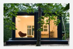 Insta_House, a pre-fab, 950 sf live/work space, made from recycled shipping containers, with a 16.5' tall living room, that can be erected on your site in one week.