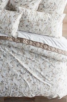 The ultra-modern Philomena Bedding Collection takes a contemporary approach to traditional fine linens. The beautiful watercolor style print is brought to life in soft shades of blush and gray for a bold, designer look. With its fashion-forward design, this collection will be a stunning centerpiece of your decor.