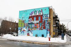 A mural pays tribute to the work of Nihonga artist Muyuki Tanobe, known for painting the street life of Montreal.