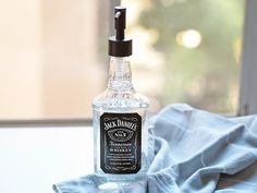 Looking for a budget friendly and personal last minute gift idea? Look no further than this quick and easy DIY Jack Daniels soap dispenser!
