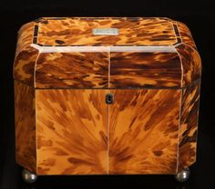 A large and fine blonde tortoiseshell tea caddy with ivory stringing, the two interior compartments with matching tortoiseshell covers. The initialled silver coloured metal tablet to the lid engraved with initials and the date 1813.