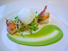 Seared scallops, pea puree, crispy pancetta, shoots and cumin foam