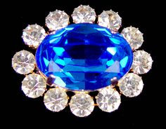 The Prince Albert Brooch of a large oval sapphire was given to Queen Victoria by Prince Albert of Saxe-Coburg-Gotha on Sunday 9th February, 1840 at Buckingham Palace. For their wedding in The Chapel Royal, St James's Palace, she wore it with her Turkish diamond necklace and earrings, In her will she instructed that it was to be considered a crown piece of jewellery and held in trust for all future Queens of Britain. Queen Alexandra and Queen Mary often wore the brooch.