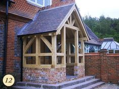 An oak framed porch can provide a welcoming entrance to your home, completely transforming its look and… Oak Front Door, Front Door Porch, Front Porches, Porch Canopy, Door Canopy, Oak Framed Buildings, Victorian Porch, Building Images, External Doors