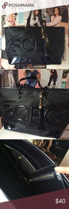 bcbg paris + logo tote Roomy enough for a work trip carry on, chic enough to look like you're jetsetting to Monte Carlo! This BCBG Paris tote is pebbly black with midnight blue letters and trim and gold hardware. When I bought the bag I didn't notice a flaw at the top of each strap. I believe it can be very easily fixed with some superglue, but I've priced it accordingly. NWT. BCBG Bags Totes