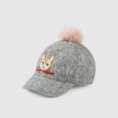 Gucci  Wool cap with cat $ 270 Grey wool felt with embroidered cat appliqué Elastic detail at Back lining with grosgrain ribbon band Made in Italy
