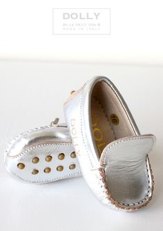 Silver driving mocs for babies. I can't even. This site has the cutest baby shoes I've ever seen.