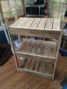 Tiered laundry basket holder made from recycled pallets.