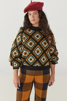 An entirely hand-crocheted sweater, featuring a ribbed mock neck and matching cuffs and waistband. This dynamic pullover references a vintage crochet stitch and is created in our hand-dyed, worsted weight yarn. It is the perfect statement sweater to prepare for the new season in style and warmth.