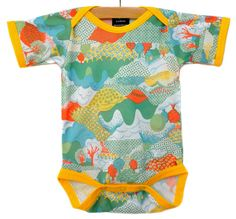 This onesie is done in a vintage landscape print fabric from the 70s. The colors are as vibrant in person as they are in the picture! It is a polyester