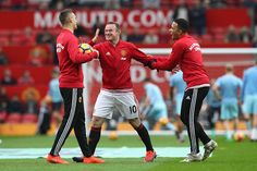 Wayne Rooney of Manchester United shares a smile with his Morgan Schneiderlin of Manchester United and Memphis Depay of Manchester United during the...