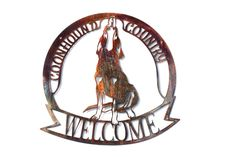 What do Black and Tan, Bluetick, American English Redtick, Plott, Redbone, and Treeing Walkers all have in common? They are all Coonhounds! Show your love with this unique baying Coonhound Welcome Sign! Cut from 14 gauge steel, these welcome signs measure in at approximately 14 x 13.75, though we