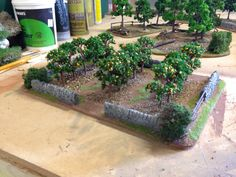 Orchard created with cheap model trees from China. Based on hardboard with wall details built from insulation foam. Created by Rich Goss Bolt Action Game, Bolt Action Miniatures, Model Tree, Warhammer Terrain, Game Terrain, Wargaming Terrain, Fairy Garden Accessories, Planting Flowers, Grass