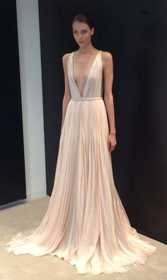 A stunning, blush pink deep V-neck wedding dress spotted at @jmendel | Brides.com