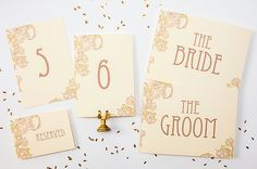 DIY printable table number signs, bride and groom chair signs, and guestbook signs.