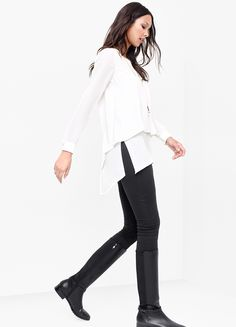An ethereal creation, this billowy layered blouse was designed to glide as you walk. | White House Black Market