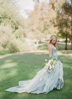 Blue wedding gown via Wedding Sparrow blog - http://weddingsparrow.com