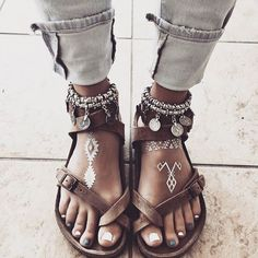 I'm still not sure how I feel about Birks... But these are certainly styled up to the max. Loving the anklets. Too bad about the hideous pedicure...