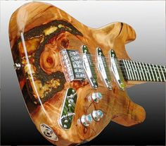 Luthier Joh Lang makes his Langcaster guitar bodies from Swamp Kauri, a preserved New Zealand wood carbon-dated to be 35,000 years old. Kauri wood is typically found by farmers digging up fields. Lang leaves the bodies unpainted to show the extremes of the grain.